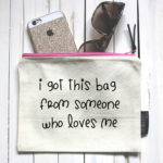 A high quality, super thick, lined canvas make-up bag with a quality zip fastening, featuring quote 'I got this bag from someone who loves me'.