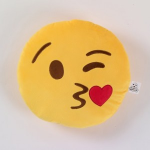 Fun emoji cushion with winking face blowing kisses