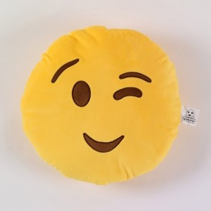 Cute and cheeky emoji cushion with winking face