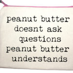 peanut butter doesnt ask questions peanut butter understands' makeup bag from design essentials in saffron walden