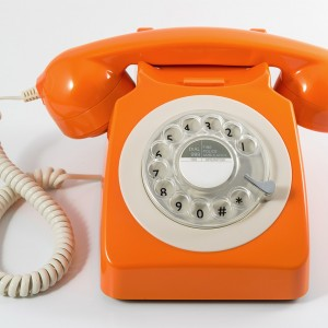 Retro Rotary Phone in Orange