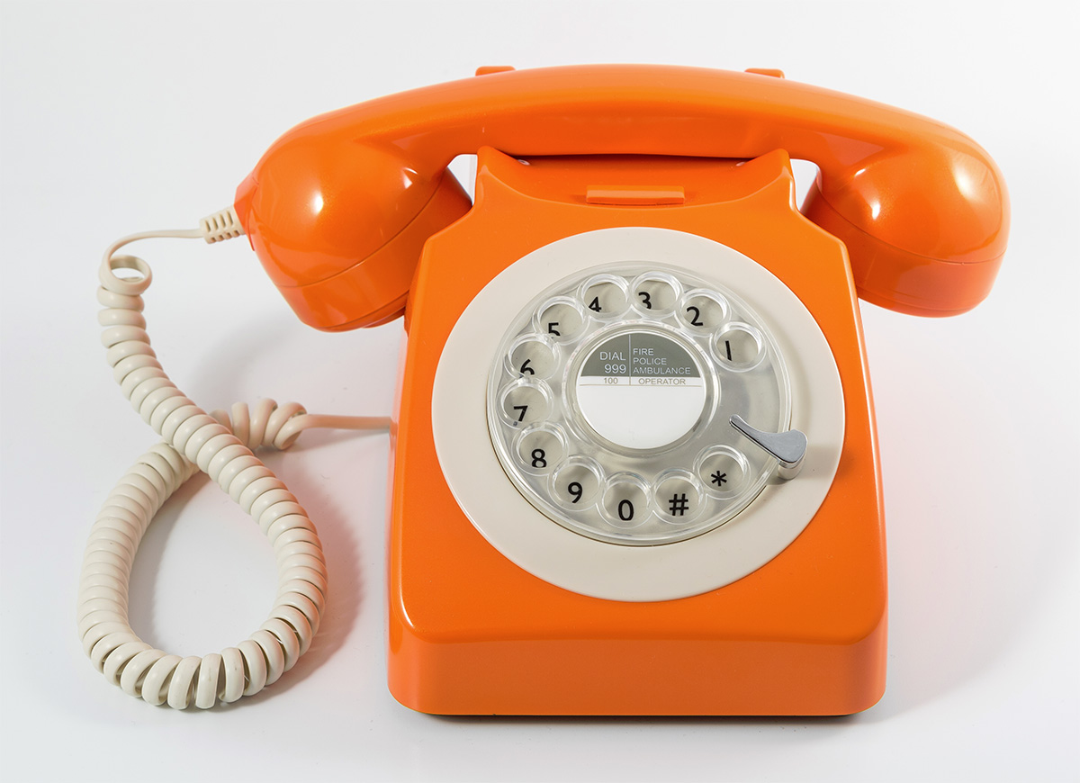 Retro Rotary Phone In Orange Design Essentials