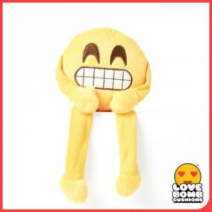 Cheesy grin emoji shelf buddy from Design Essentials