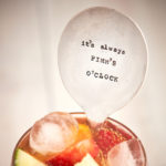Large vintage style drinks stirrer with 'it's always Pimm's O'clock' quote.