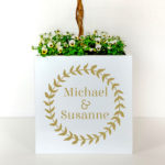 Metal planter personalised with names in gold letters for a wedding.