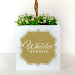 Metal plant container personalised with the name of the couple for decorating a wedding venue.