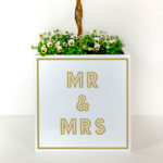 Mr and Mrs plant pot for weddings with gold letters on white background.