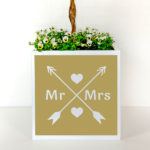 Mr and Mrs plant pot for weddings with love arrows.