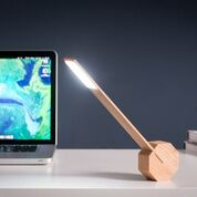 octagon one desk light maple angled on design essentials gingko